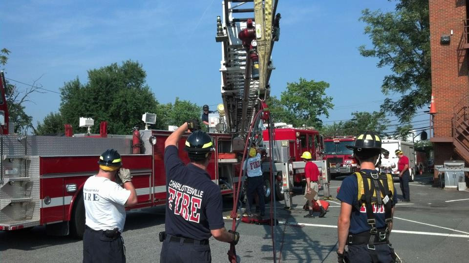 Firefighters deploying the ladder